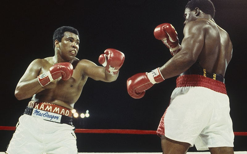Muhammad Ali throws a left hook and misses Trevor Berbick at the Queen Elizabeth Sports Centre on December 11, 1981 in Nassau, Bahamas. Berbick defeated Ali in the tenth round. (Focus on Sport via Getty Images)